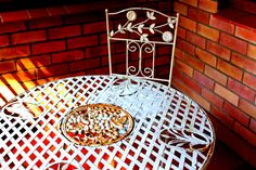 Wrought iron table and two chairs