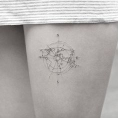 Delicate travel tattoo by Sanghyuk Ko
