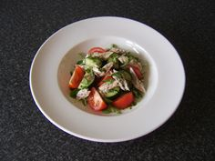 A really easy recipe for poached mackerel salad. The mackerel is cooked and cooled before being carefully removed from the bone in large flakes and added to a peashoots, tomato and cucumber salad.