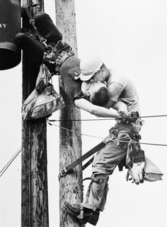 'The Kiss of Life' photographed by Rocco Morabito, winner of the 1968 Pulitzer Prize. J.D. Thompson giving mouth-to-mouth resuscitation to his fellow Florida power company lineman R.G. Champion, who had received a 4,160-volt electric shock after coming in contact with a hot wire atop a utility pole.