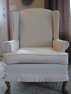 wingback chair with pleated skirt
