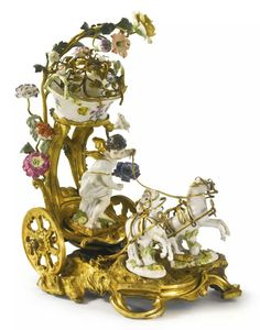 A LOUIS XV ORMOLU AND MEISSEN PORCELAIN CHARIOT GROUP mid-18th century.