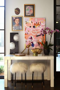 parsons table with art wall above