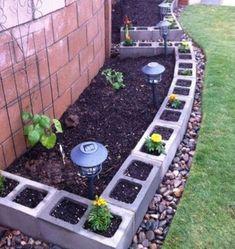 cinder block as perimeter of pea gravel patio