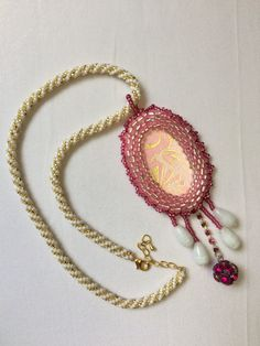 A+necklace+in+pink+white+and+gold.+A+crocheted+white+gold+chain+and+a+pink+bezeled+pendant.+ Pink White, White Gold, Pink Pendants, Crochet Earrings, Handmade Jewelry, Pendant Necklace, Chain, Fashion, Moda