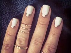 Textured gold bands stand out even more when placed next to a reverse French mani with a gold stripe. Have silver rings? Try the same design with a swipe of pewter instead. See more at ThenLetItBe.Tumblr.com »