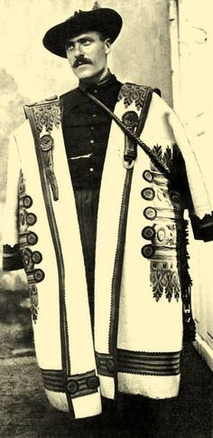 The Hungarian szür is derived from mantles over 2500 years old, and continued to be worn into the early 20th century. The garment was worn by shepherds mostly, providing protection from the harsh elements. Their thick wool felt was protective against cold and wet, and the long collars were adorned with roundels at the lower corners that could be connected to form a hood.