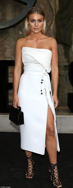 Sizzling start: Blonde beauty Elyse Knowles put on a leggy display in a rippling white Toni Maticevski top and skirt combo for the Australian Fashion Week festival's opening lunch on Sunday