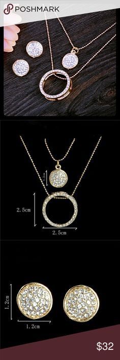 18K Gold Australian Crystal Circles Jewelry Set Brand New- Gorgeous 18K gold filled Australian crystal circles jewelry set. Includes sparkling double layered necklace: longer necklace has an open circle with crystals around it, while the shorter necklace has a crystal filled circle. The drop earrings are the same size and style as the shorter necklace, the top layer. All of the measurements are shown in the pics. This set is perfect for the nights out, business, or a casual chic everyday…