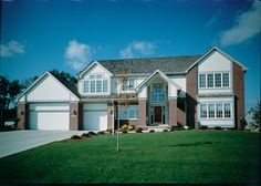 Dramatic windows and light into this spacious Luxury home.  Luxury House Plan # 271032.