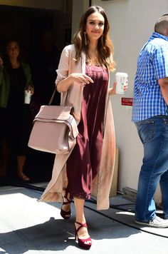 Jessica Alba's outfit had a romantic vibe. Alba wore a maroon coloured dress and matching heels and a blush overcoat as she walked around New York City with a coffee.