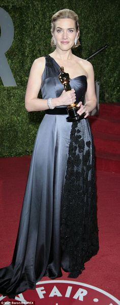 Kate Winslet looked classic in slate satin with beaded lace by Yves Saint Laurent in 2009 when she won her Oscar for The Reader.