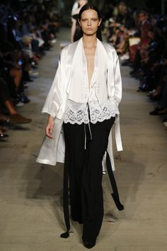 The tuxedo-style detailing on this shimmering kimono. The pairing of the menswear vest with lace. Lovely. Givenchy Spring 2016 Ready-to-Wear. Model: Mina Cvetkovic