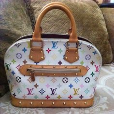 Louis Vuitton Murakami Alma Authentic Louis Vuitton Murakami alma         Used but in good condition As shown on the pictures .                                                                  Comes with dust bag.                                               I can post more pictures if needed Louis Vuitton Bags Satchels