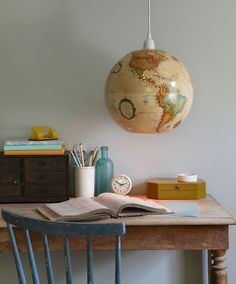 We're positively glowing over this new use for an old globe, devised by contributing editor Andrea Greco. To create your own pendant, you'll need a 12-inch-diameter cardboard globe (as little as $15 on Etsy or eBay), plus a pendant light cord kit ($15; pbteen.com). First, remove your globe from its base, if necessary. With a utility knife, carefully make a 3½-inch-diameter opening at the bottom of your globe, using its latitude lines as a guide (convenient, right?). Then, holding the light…