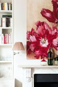 { Pink flower painting above a marble fireplace in a townhouse designed by Flora Soames }