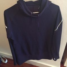 Nike Dri-fit wool training hoodie Extra long, wool training hoodie! Nice dark purple color and very warm. Reflective strips on sleeves, starting to come off on one said but barley noticeable! Also see photo of eyelets for hood stings. Nike Tops Sweatshirts & Hoodies
