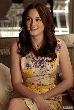Purple and yellow dress. Patterned dress. Yellow bow. V-neck. Sheath dress. Knee-length dress.