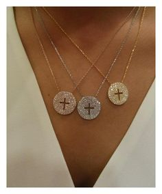 Gold, silver, and rose gold cross necklaces.