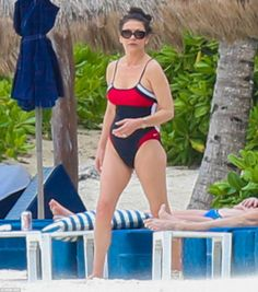 Still a Darling Bud:Catherine Zeta-Jones, 46, reveals her incredible figure in a swimsuit as she relaxes on the beach with Michael Douglas in Cancun, Mexico, on Wednesday