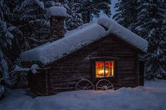 A little log cabin in the snow, Sweden.