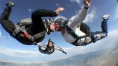 Couple skydiving- would you be brave enough to try this?!