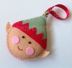 This cute Elf Christmas decoration is designed and hand stitched by Devonly Crafts in Devon, England. Ernie the Elf is made with felt and is