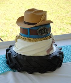 Country Theme Wedding Dresses | Tiers, with a cowboy hat, blue jeans & belt, Wedding dress inspired ...