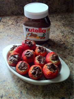 Cut a hole in the top of your strawberries and fill with nutella! delicious and easy