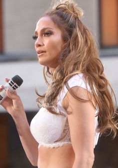 """5a54ae37fccb9 Jennifer Lopez performs """"Love Make the World Go Round"""" to honor the victims  of the Orlando shooting on the """"Today"""" show at the Rockefeller Plaza"""