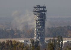 A Ukrainian flag flies over the traffic control tower of Donetsk Sergey Prokofiev International Airport during an artillery battle between pro-Russian rebels and Ukrainian government forces on October 1 Billion Dollars, Buy Photos, Seattle Skyline, Ukraine, Battle, Tower, Architecture, International Airport, Building