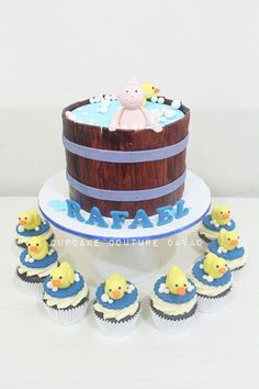 Baby on a tub cake with rubber ducky toppers cupcakes by Cupcake Couture Davao  www.facebook.com/cupcakecouturedavao