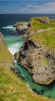 Carrick-A-Rede Rope Bridge Ireland's Causeway Coast- Giant's Causeway, Dark Hedges & Belfast.  Hike to the Carrick-A-Rede Bridge. The hike is lovely, taking you along the coast with great scenery and eventually ends at a tiny suspension bridge that allows you to cross over to the island of Carrick. The bridge is narrow and airy creating a thrill when the wind picks up a little. http://www.divergenttravelers.com/irelands-causeway-coast-giants-causeway-dark-hedges-belfast/