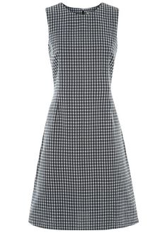 Hand woven navy dress with geometric pattern in 100% cotton. Woven entirely by hand, this sleeveless dress features a soft flare and concealed back zip fastening. Length 102cm.