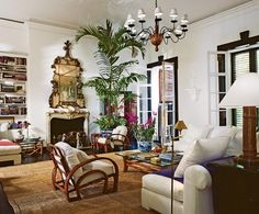 Ralph & Ricky Lauren's home on Jamaica: An 18th-century gilt mirror hangs above the fireplace in the living room, which also has a reading corner.