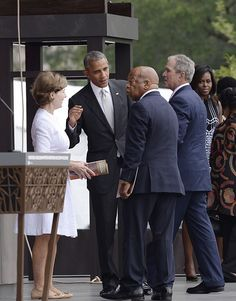 Former First Lady Laura BushUS President Barack Obama Rep John Lewis former President George W Bush and First Lady Michelle Obama attend the opening...