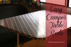 Tablecloth stretched and stapled over old table top