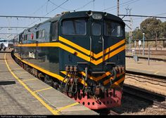 Two beautifully restored electric locos of Rovos Rail parked at the Krugersdorp station. On the left in the distance the Transkaroo that brought us here about to depart again. ~ Gauteng, South Africa by Fanie Kleynhans South African Railways, Railroad Photography, Electric Locomotive, Train Journey, Locs, Distance, Diesel, Engineering, Park