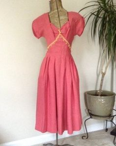 Do you love vintage dresses? This one is so cute! Pink with yellow detail. They just don't make dresses like this anymore! #vintagefashion #1950s #etsy   https://www.etsy.com/listing/247345083/tina-leser-dress-by-foreman-gorgeous