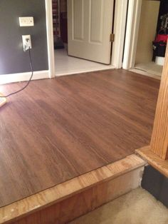 laminate flooring I did in my hallway after water leak from bathroom. Purchased flooring from Menards, $17.98 a box, covered 15 sq feet.