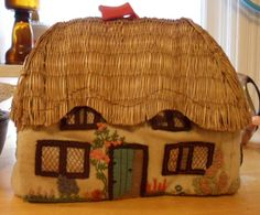 Handmade thatched cottage tea cosy with incredible embroidery. $50.00, via Etsy.
