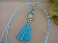 Greek Macrame Turquoise and Blue Drop Evil Eye Necklace with Tassel by ForThatSpecialDay on Etsy