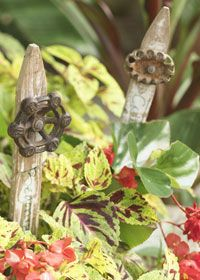 cute garden art from old fence post and faucet handle