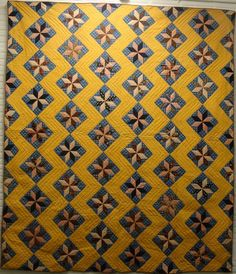 LeMoyne Stars within a Zigzag sashing, a pieced quilt c. mid 19th c with great color and fabrics