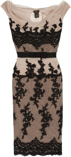 Collette Dinnigan Cocktail Dress of black ornate lace over a pale nude fabric.