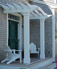 curved pergola above front door, top pieces running parallel instead of perp.
