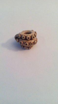 Brown octopus tentacle dread bead. Dreadlock by Miasdreadlockbeads