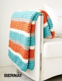 The Get Fresh Throw is a a great beginner knitting pattern you won't want to miss. Freshen up your home decor with this vibrant knit throw blanket. This blanket is an ideal beginner pattern in a fresh, fun colorway.