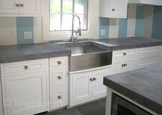 Love the concrete counter with stainless apron sink and industrial faucet.