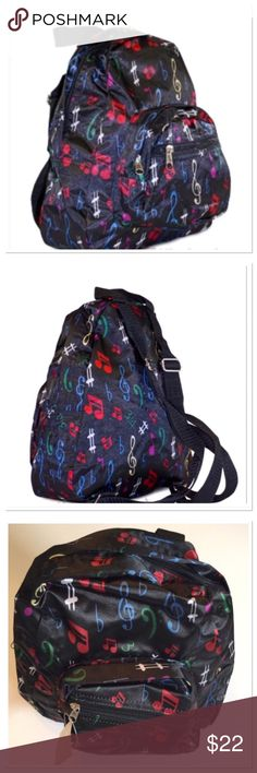 """Music Notes Mini Backpack Music notes print mini backpack. Constructed of microfiber to endure roughness, 2 exterior zippered pockets, lightweight water resistant 11"""" L x 9"""" W x 3.5"""" D Boutique Accessories Bags"""